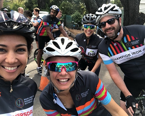 Group of smiling Bike Ride For Brain Cancer participants on their bikes